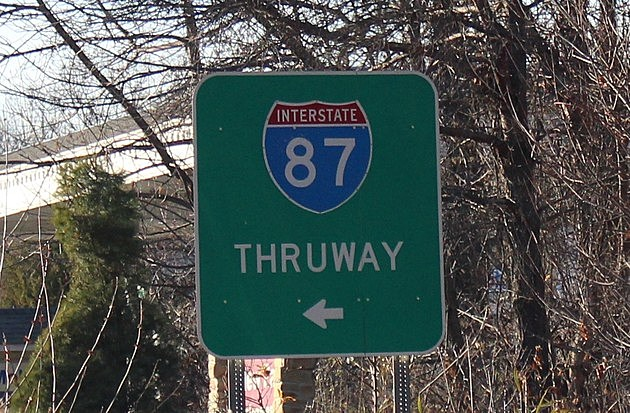 A New York State Thruway/I-87 road sign.
