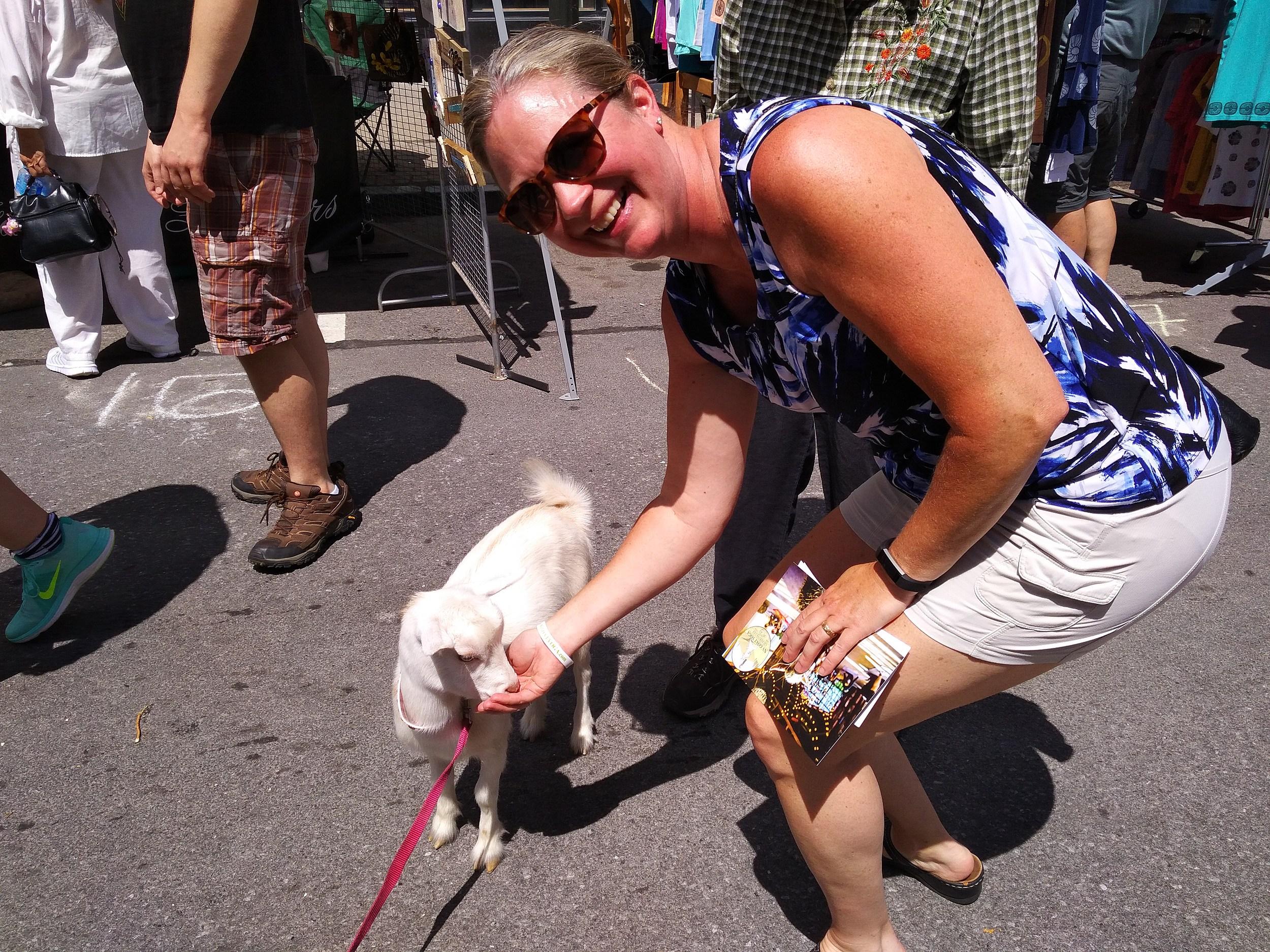 Leslie Ann feeding one of the NY Goat Yoga goats (TSM)