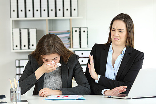 Ill businesswoman and a colleague rejecting her